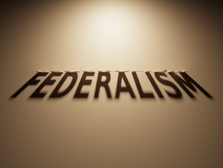 upside: A 3D Rendering of the Shadow of an upside down text that reads Federalism.