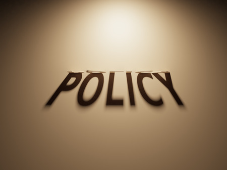 upside: A 3D Rendering of the Shadow of an upside down text that reads Policy.