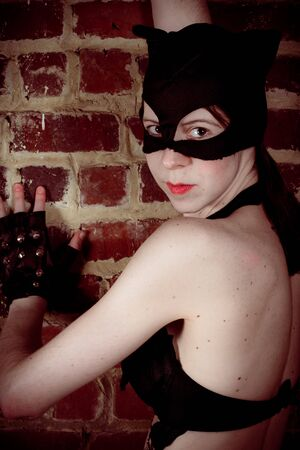 catwoman against wall photo