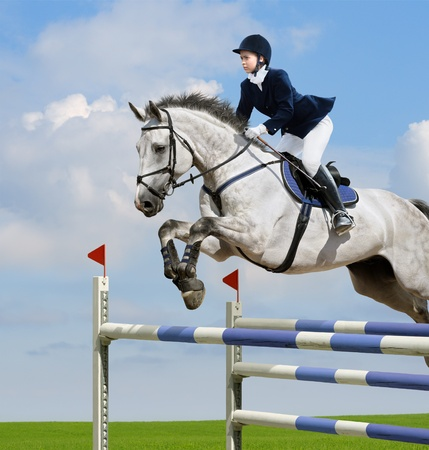 Young girl jumping with sorrel horse photo