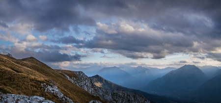 autumn colour: Evening in mountains.View of Caucasus mountains from a mount Zagedan slope. Karachay-Cherkessia. Russia.