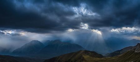 heavy rain: Heavy rain over mountains. View of Greater Caucasus Mountain Range from a mount Zagedan slope. Caucasus mountains. Karachay-Cherkessia. Russia. Stock Photo
