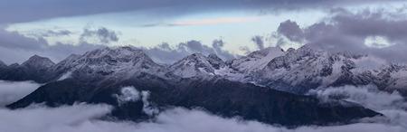 winterly: Snow-covered top of Greater Caucasus Mountain Range in morning twilight. Caucasus mountains. Karachay-Cherkessia. Russia. Stock Photo