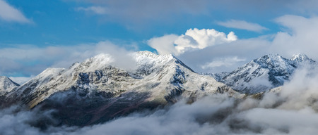 winterly: First snow at tops of mountains. Dawn. Greater Caucasus Mountain Range. Caucasus mountains. Karachay-Cherkessia. Russia.