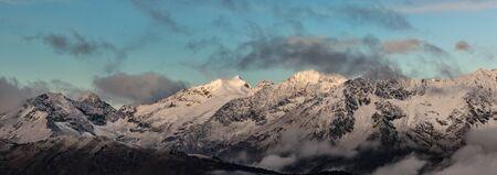 winterly: First beams of a rising sun it is high in mountains. Adzharo-Imeretinskiy Range. Northwest spurs Greater Caucasus Mountain Range. Caucasus mountains. Karachay-Cherkessia. Russia.
