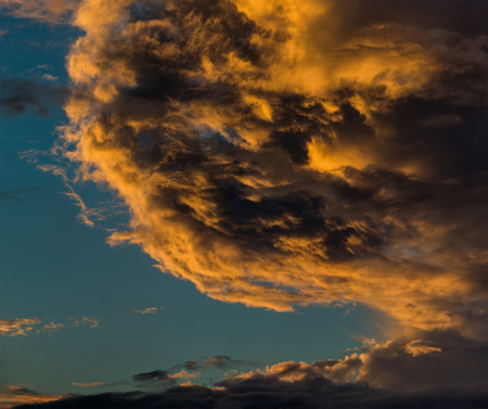 gold colour: Sunset cloudscape - gold clouds in the sky  Stock Photo