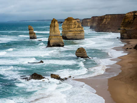 The 12 apostels stands tall as the mighty pacific ocean crashies ashore along the great ocean road melbourne