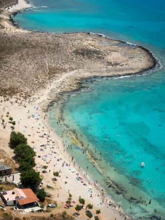 blue pink and white sand and ocean in one of greeces most iconic lagoons Stock Photo