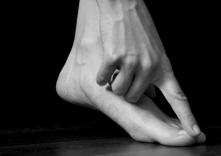 delicacy: Finger touching toe, elegance, grace, delicacy