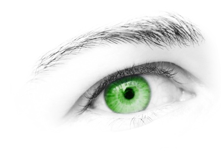 Green eye of female looking straight ahead Stock Photo