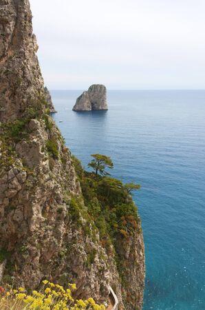 Coast of Capri Island, view of sea and sea-cliff photo