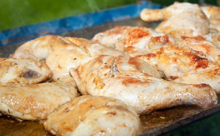 Chicken with honey and spices, cooking on a wood fire