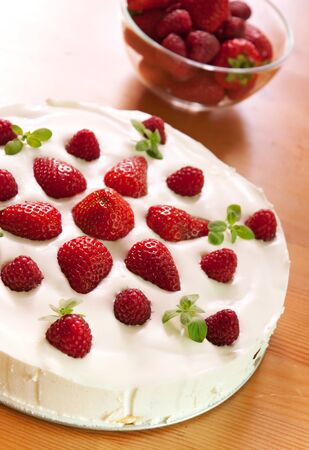 Homemade cake made from cream with strawberries and raspberries