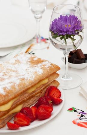 Homemade cake, pastry cream and strawberries photo