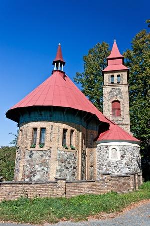 parish: Small church in a hamlet of northeast of Bohemia - Czech Republic Stock Photo