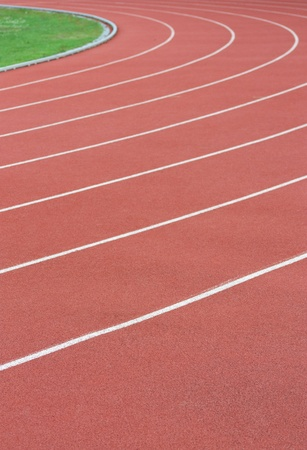 Athletics track with its lane, white lines and turn photo
