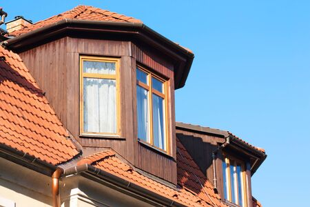 Tiled roof and wooden windows photo