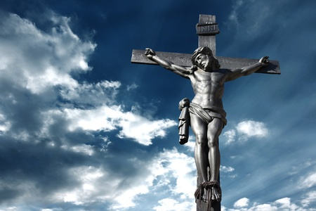 Illustration of the crucifixion of Jesus Christ with a stormy sky recalling the anger of God illustration