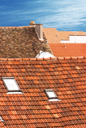 Landscapes of roofs with a blue sky in background Standard-Bild