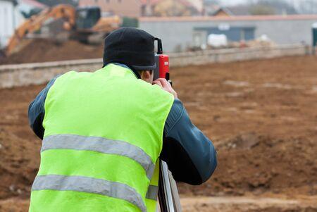 archaeologist: Building surveyor taking measurements on a construction site
