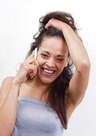 Nice woman laughing on the phone, white background Stock Photo - 13664446