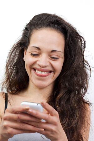 Happy young woman writing a message on her smartphone Stock Photo - 13664448