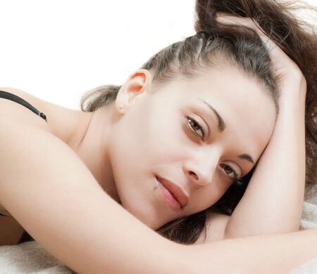 Pretty brunette lying with very sensual look photo