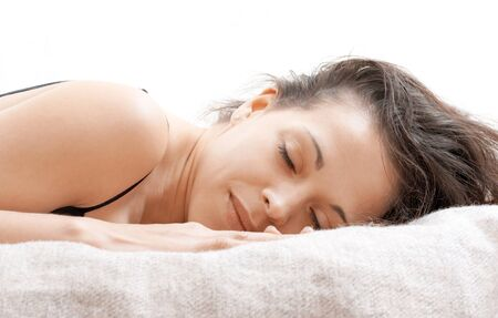 rested: A woman lying on a bed with a rested face  Stock Photo