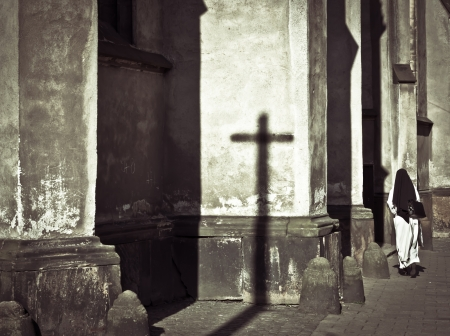 worshiper: Dark and mystical atmosphere with a nun entering in a church
