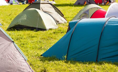 vacationer: Camping full of tents and vacationer Stock Photo