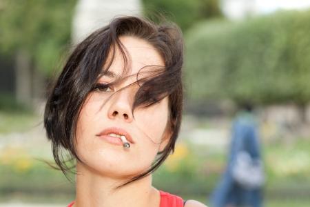 sexy girl smoking: Portrait of a sexy girl smoking a cigarette