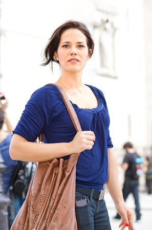 Nice brunette walking on the street of Paris Stock Photo - 15500571