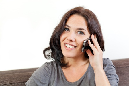 Nice brunette phoning and smiling