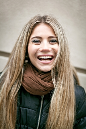 Closeup portrait of a cheerful young woman Stock Photo