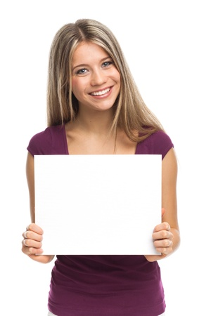 Young woman showing a white signboard, isolated on white Standard-Bild
