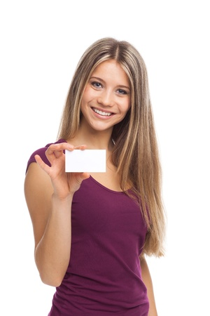 Young beautiful woman showing a white card, isolated on white