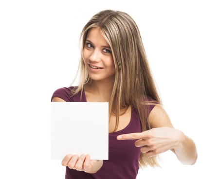 Smiling young woman showing a white card, on white Standard-Bild