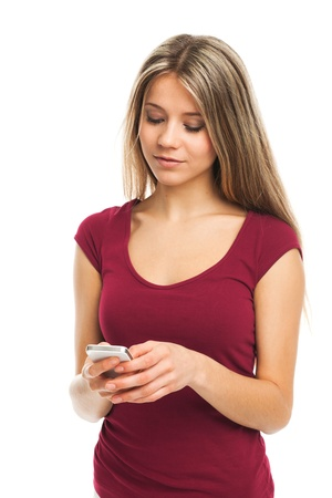Beautiful girl writing a message on her phone, on white