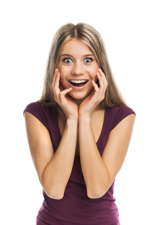 Young blond woman looking very surprised, on white Stock Photo