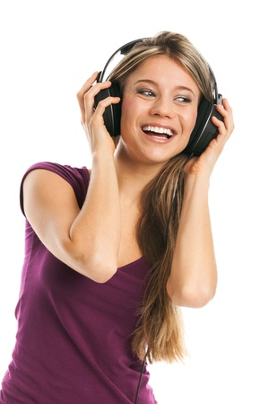sexy headphones: Happy young woman listening music with earphones, on white
