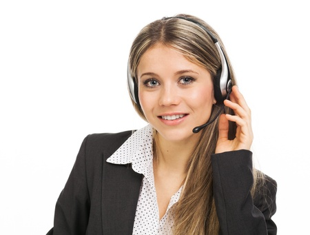 Young woman with headphones illustrating hot line, help desk, on white