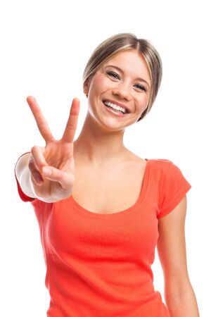 Young woman showing two fingers, positive or peace gesture, on white photo