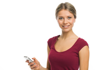 Pretty girl holding her smartphone and smiling, on white Stock Photo