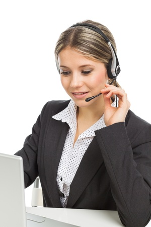Beautiful young woman with headphones and laptop illustrating business service, on white