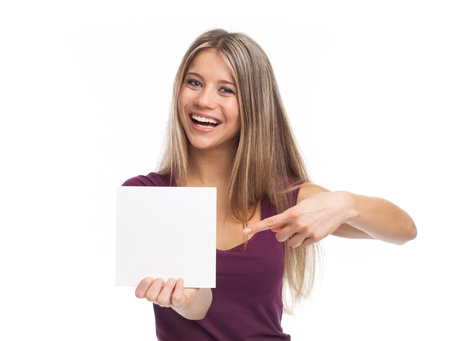 Young woman showing a white signboard, isolated on white Zdjęcie Seryjne