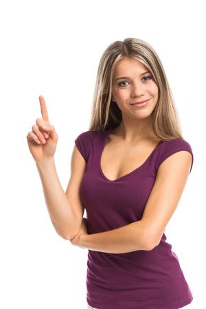 Nette junge Frau zeigt etwas auf der Oberseite, auf weißem Standard-Bild - 18057284