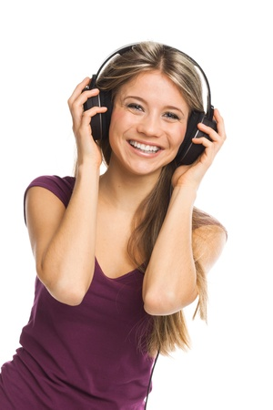 sexy headphones: Cheerful young woman listening music with headphones, on white Stock Photo