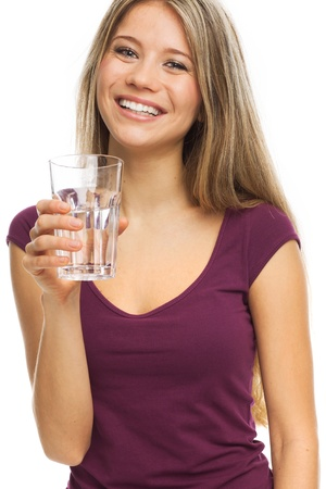 Nice young woman drinking a glass of water, on white Standard-Bild