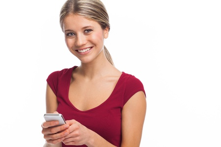 Smiling woman writing a message on her phone, on white Stock Photo