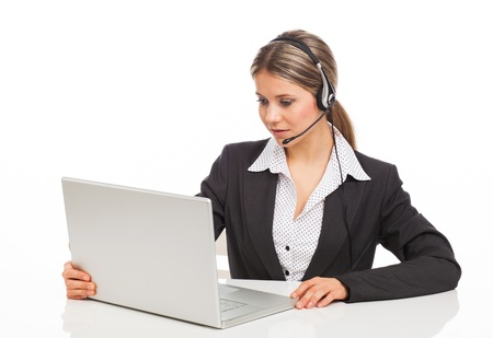 computer operator: Blond girl with headphones and laptop illustrating business service, on white Stock Photo